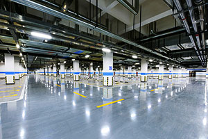 Image of an industrial carpark with reflective lighting